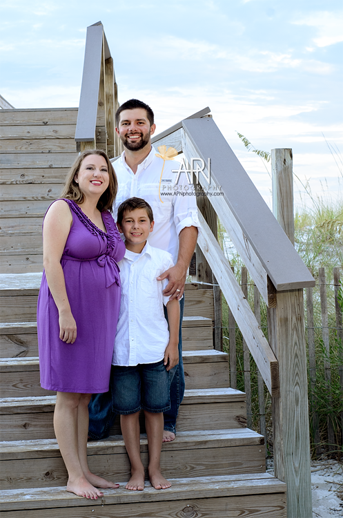 family portraits at sunset by the stairs at the beach