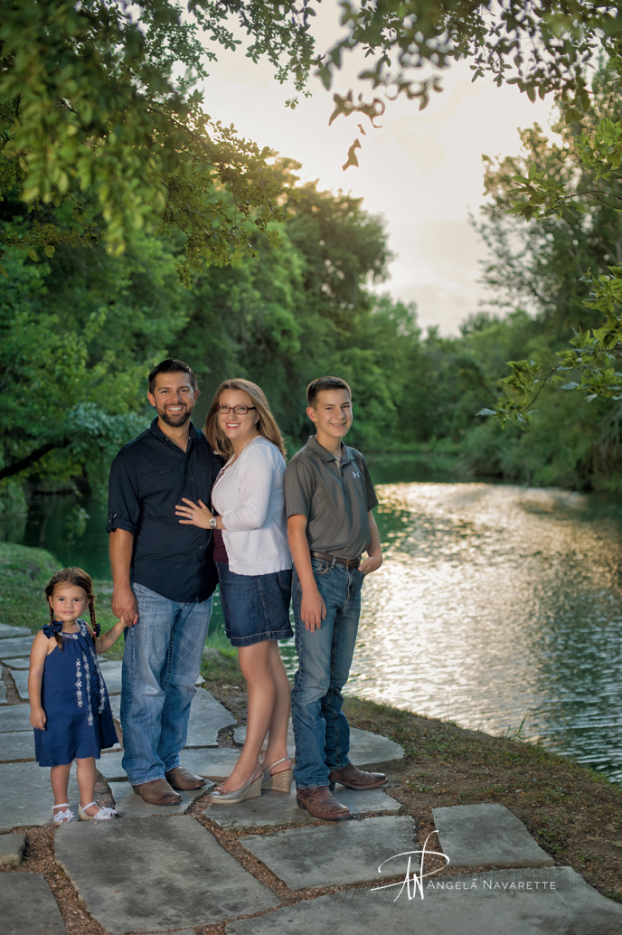 family portraits at sunset in front of the pond