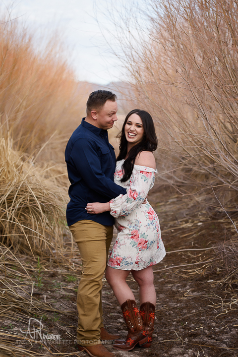 couples portraits session texas embrace laughing
