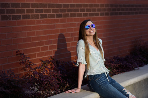 Senior Girl with sunglasses in direct sunlight
